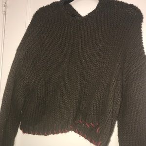 Brown and red stitched sweater.